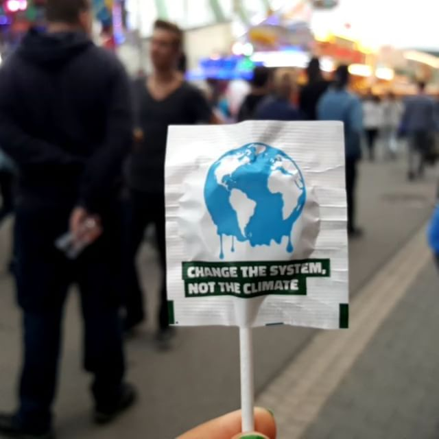 "Give-Away (Lolli) mit Aufschrift ""Change the System, not the Climate"""